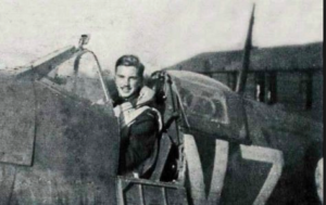 John Gillespie Magee, Jr seated in his Spitfire
